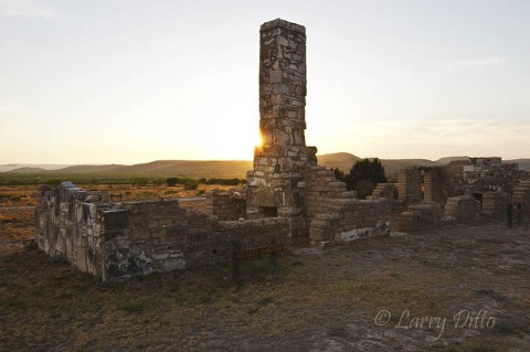"A little ""star burst"" effect as the setting sun slides past a chimney in the Fort Lancaster soldiers' quarters."