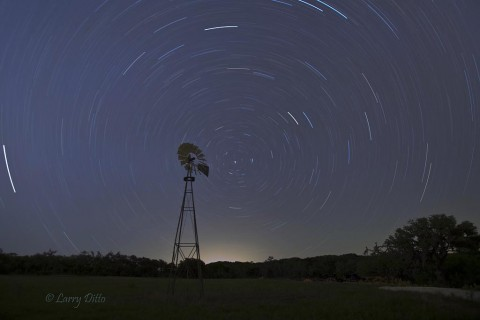 Star trails behind the old windmill right outside the front door.
