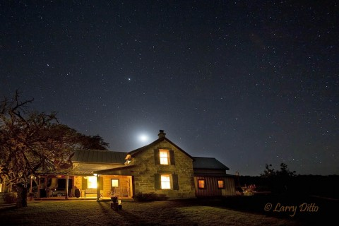 The Block Creek Natural Area Bed & Breakfast on a cool, clear night with crescent moon.