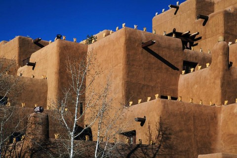 A Santa Fe hotel with luminaria along the walls.