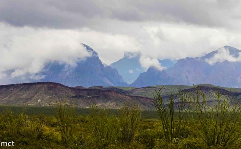 Fog and rain hanging on the Chisos Mountains next door to the Christmas Mountains.