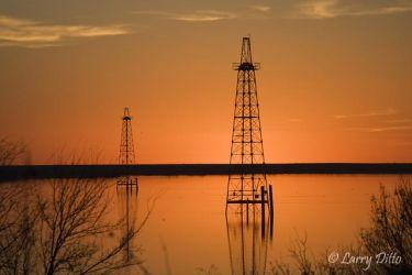 Oil wells in Lake Arrowhead at Wichita Falls, Texas, winter sunset